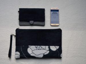 Grande pochette de la marque Bleu Souris suédine noire et fleurs blanches