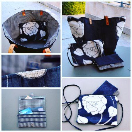 Vue d'ensemble du cabas xl et de la pochette du sac noir avec de grosses fleurs blanches. Marque Bleu Souris.
